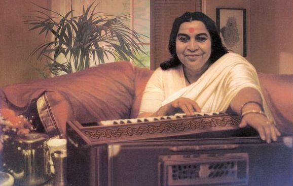 Shri Mataji playing harmonium.